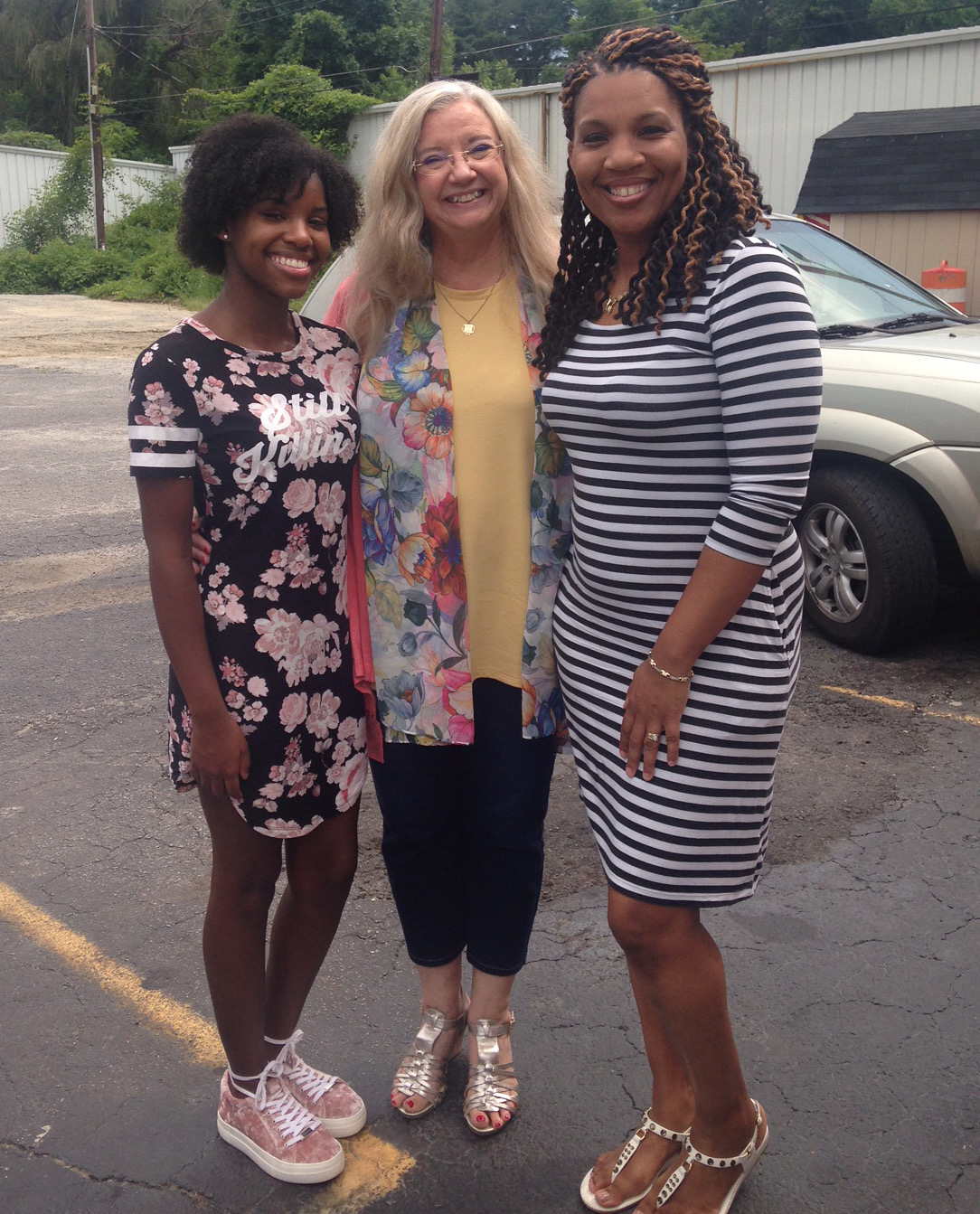 Tameron Hill with Brenda McCleerey and Erica Cook.