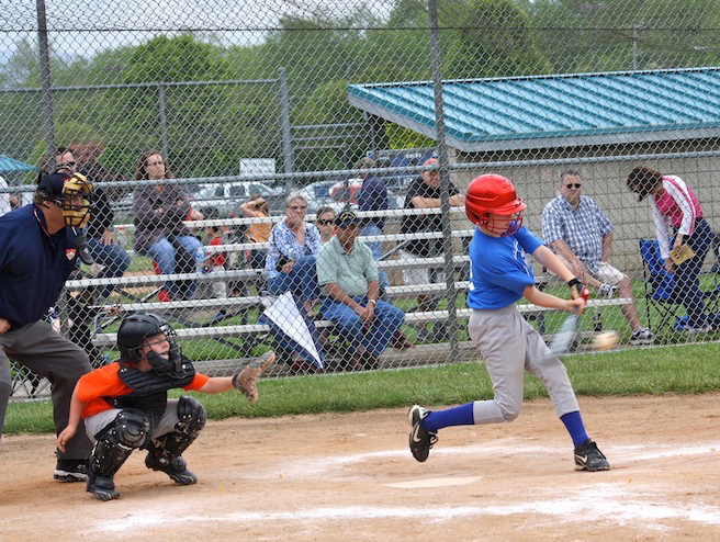 Luke Taylor gets a hit on opening day of baseball season at Fletcher Park.