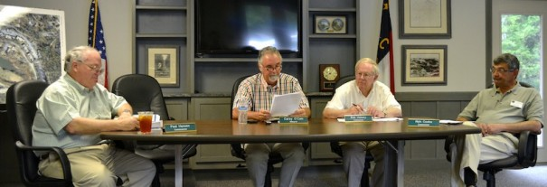 Laurel Park town board members Paul Hansen, Mayor Carey O'Cain, Bob Vickery and Rich Cooke review town budget.