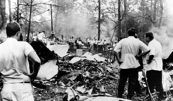 Fire and ambulance workers search through the wreckage for bodies after a Piedmont Airlines jet and a Cessna 310 collided in mid-air and crashed in woods near Hendersonville on July 19, 1967. (ASSOCIATED PRESS PHOTO)