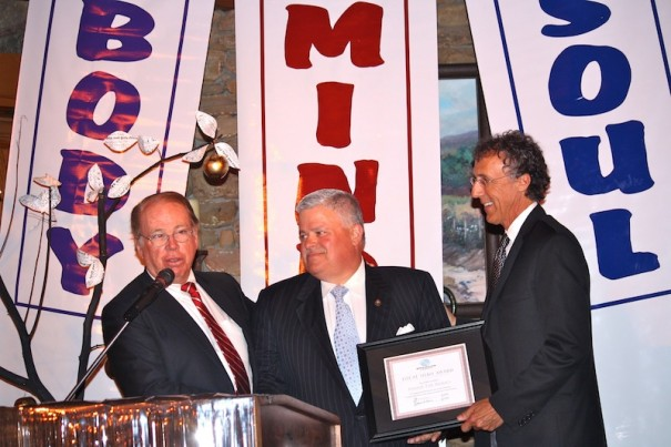 Tom Fazio, left, and Jeff Miller, right, congratulate Tom Apodaca, the 2013 Local Hero of the Boys & Girls Club.