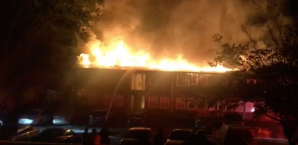 Flames engulfed one of the buildings at the Sixth Avenue Apartments at 3 a.m. Sunday. [CONTRIBUTED IMAGE]