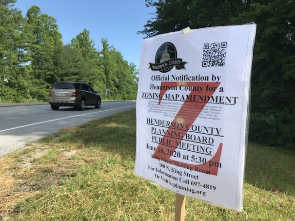 A rezoning announcement is posted on Spartanburg Highway. At the applicant's request, the Planning Board review has been postponed until Aug. 20.