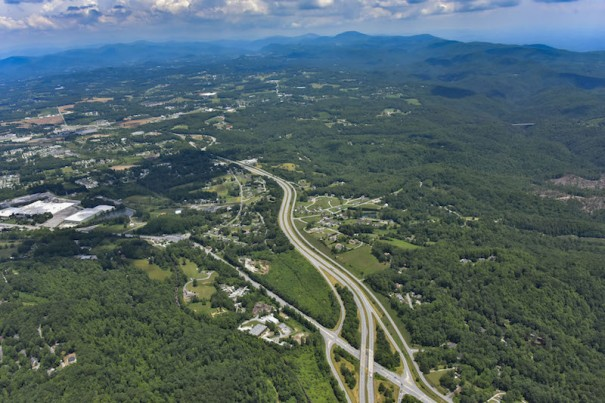 Aerial photo shows site of a proposed asphalt plant at the corner of Spartanburg Highway and the westbound off ramp of the U.S. 25 connector.  [Photo courtesy of AerialPhotoPros.com]