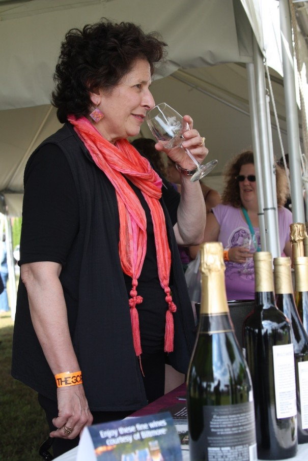 Beth Engel tests 'the nose' of a glass of wine at the first Mountain Wine & Music Festival.
