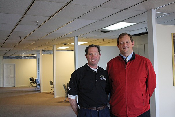 Body shop manager Mark Gerick and Les Boyd pose at new Boyd Collision Center, which has space for adjusters to work.