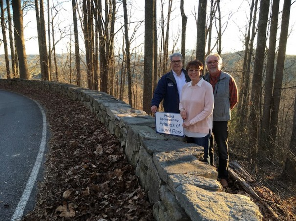 Mark Morse, vice president of Friends of Laurel Park and past Laurel Park Civic Association president; Friends of Laurel Park President Mindy Collins and Laurel Park Mayor Carey O'Cain celebrate completion of repairs of the historic rock wall on Laurel Pa