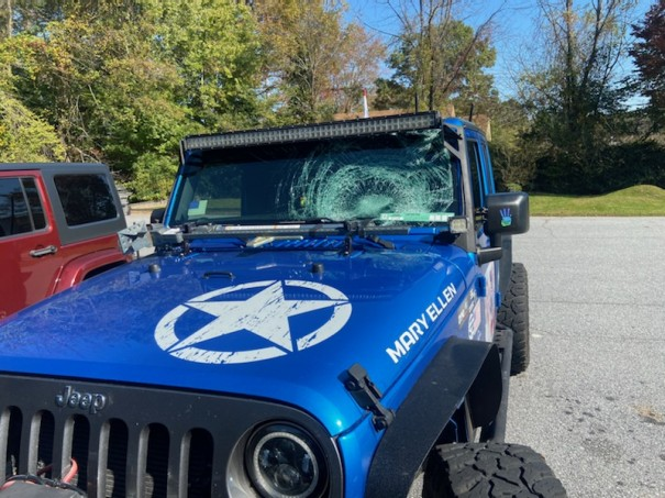 Someone in an oncoming car hurled a gallon jug of water that shattered the windshield of Andy Brogden's Jeep.