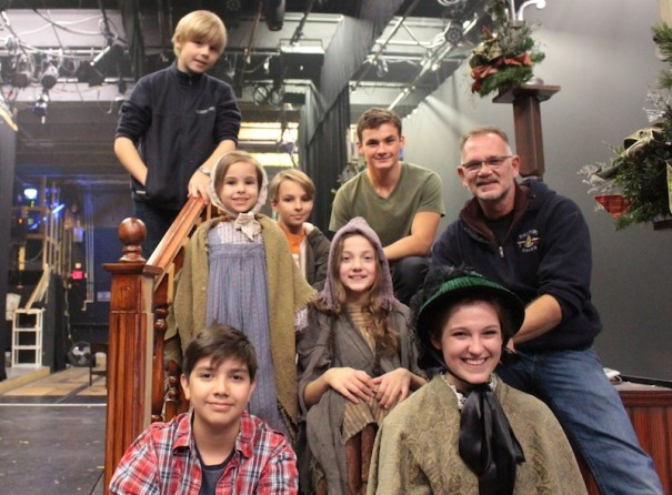 Young actors in 'A Christmas Carol' are, front row, Ezekiel Mercado and Lainie Robertson, and second row, Clarke MacDonald, Kyra Hewitt, Riley Hewett, Lily Bates and James Dillon, with Dave Hart, YouTheatre artistic director and associate director of the