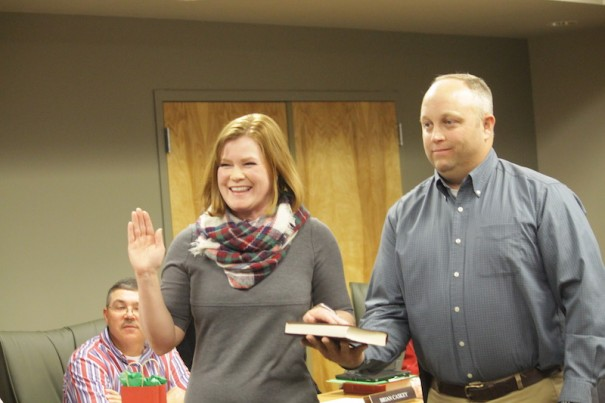 Chae Davis, with husband Jason Davis, takes the oath to serve on the Mills River Town Council.