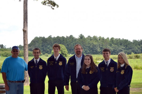 Edwards, with Danny McConnell (left), sports his FFA jacket alongside current FFA members from West Henderson High School.