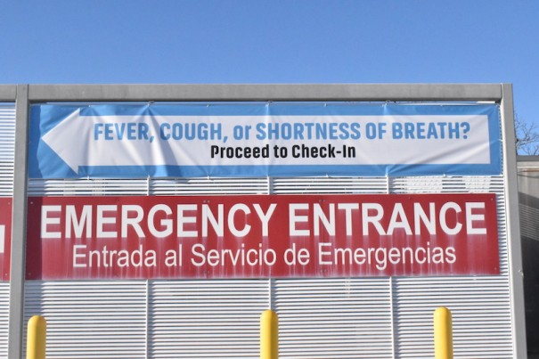 A sign at the Pardee emergency room directs potential COVID-19 patients to a screening tent outside the ER.