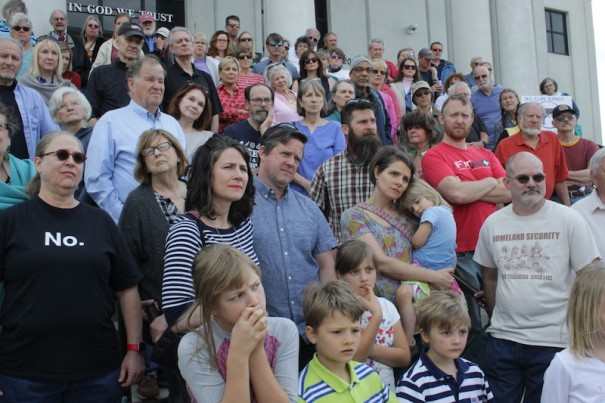Saluda residents gathered on the courthouse steps to listen to a speaker.