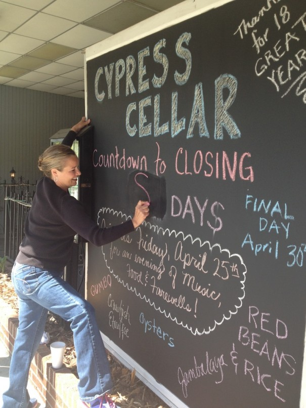 Tracy Rubianes updates the countdown on a sign announcing the closing of Cypress Cellar.