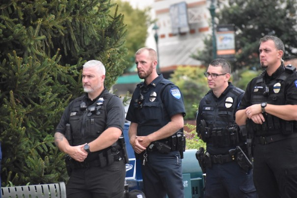 Hendersonville police officers listen to a speaker during a tribute to those lost on Sept. 11 and to Sheriff's Deputy Ryan Hendrix, who was killed in the line of duty early Thursday.