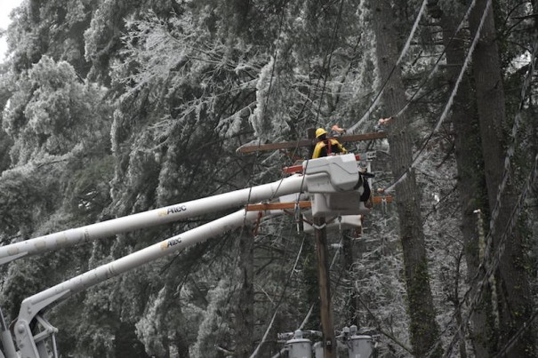 A lineman works on a power line on Greenville Highway near Rutledge Drive.