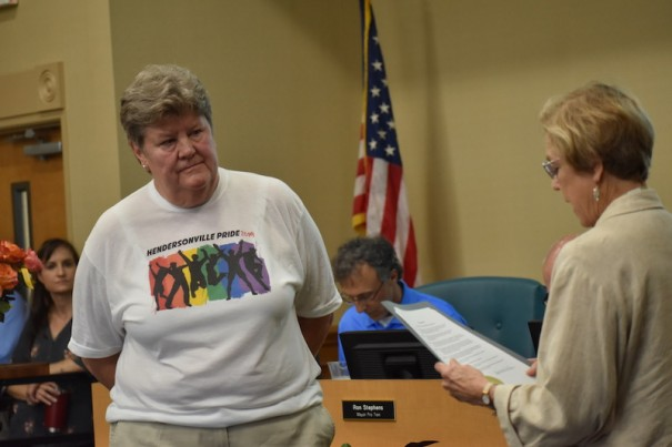 Laura Bannister looks on as Mayor Barbara Volks reads a proclamation declaring June 15 Hendersonville Pride Day.