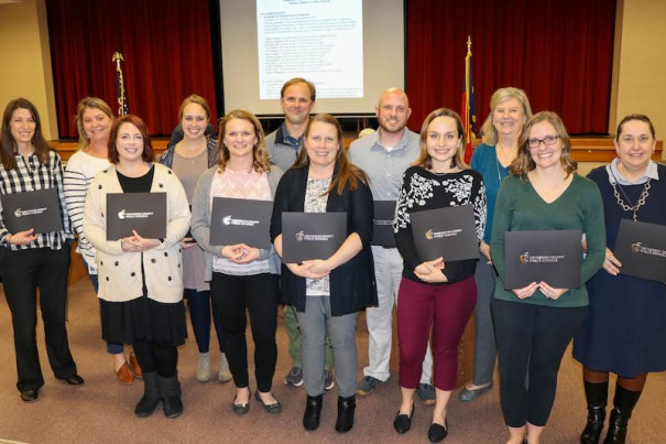 National board certified teachers are, from left, Mandi Willingham, Kelly Risley, Ashley Wellman, Kara Lindsey, Nicole Riddle, Geoff Kinsey, Jennie Quinn, Tyler Honeycutt, Zoe Faircloth, National Board Candidate Support Facilitator Lynn Carter, Dana Wells
