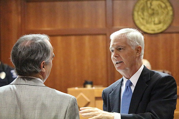 Former Gov. Mike Easley speaks with defense attorney Scott Stevenson.
