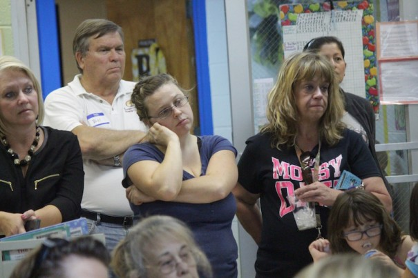 Edneyville Elementary School parents and supporters listen to School Board members during a school meeting Tuesday night.