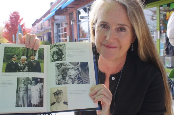 "Ellen Schwab shows photo of her uncle, Ryan McCown, from the new book ""You Are Not Forgotten."""