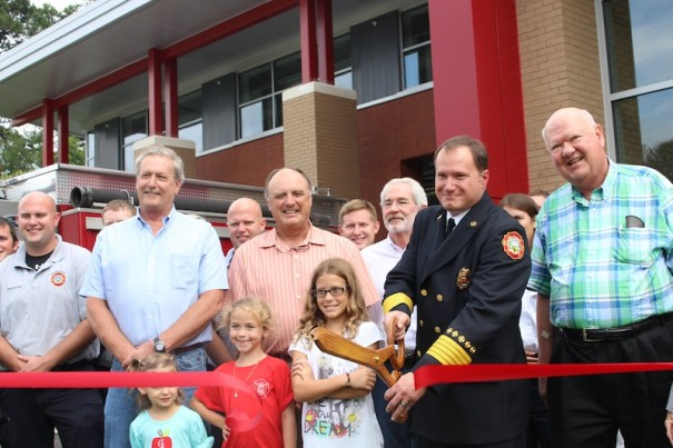 Hendersonville Fire Chief Dorian Flowers was joined by council members and others as he cut ribbon on Fire Station No. 2.