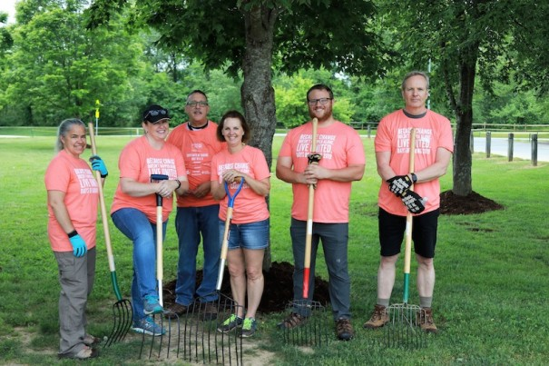 Rafaltac employees helped spread mulch at Fletcher Park Friday. [PHOTO BY PAULA ROBERTS PHOTOGRAPHY]