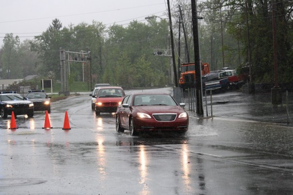 Motorists negotiate high water on King Street in Hendersonville.