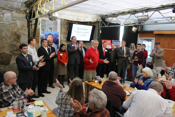 Candidates gather at the end of a GOP breakfast on Jan. 16.