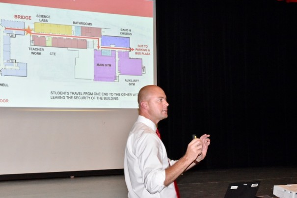 Associate Schools Superintendent John Bryant describes the construction timetable at Hendersonville High School during a presentation in the Stillwell auditorium, which Bryant described as 'integral to the heartbeat' of the Bearcat culture.