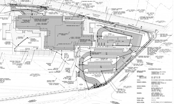 Plans on lower right show the HHS parking lot entrance lined up with North Main Street at Five Points.
