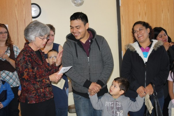 Habitat family support chair Judy Durant welcomes Daniel and Ana Cruz and their son, Gabriel.