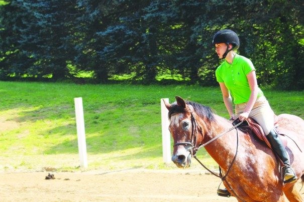 A graded riding ring, shown in a 2014 file photo with a riding student, was the subject of a lawsuit that the Carolina Mountain Land Conservancy and the Hidden Valley Farm  settled last week.