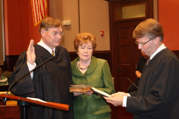 Jeff Hunt takes a ceremonial oath as a North Carolina Special Superior Court judge, joined by his wife, Margaret. Mark Martin, senior associate state Supreme Court justice, administered the oath.