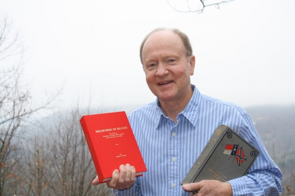 Terrell Garren, with his new 'Measured in Blood' and a reference book on North Carolina troops during the Civil War.
