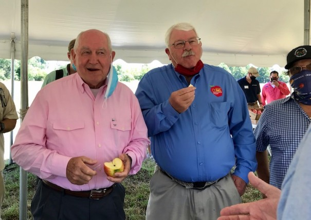 U.S. Agriculture Secretary Sonny Perdue and N.C. Agriculture Commissioner Steve Troxler sample apple slices during a tour of the Flavor 1st operation in Mills River to promote the Farmer to Family Food Box Program.