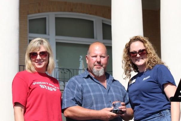 Leslie and Pat Lancaster accept the United Community Bank Apple Farmer of the Year Award from Fair Nabers Waggoner, city president of the bank.