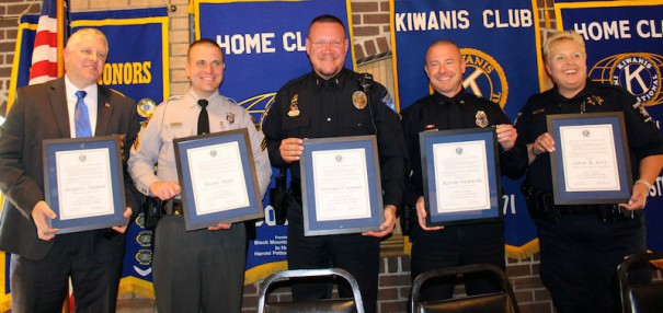 Fletcher Chief Erik Summey (left) holds Sgt. Brian Fulmer's award. Other law officers honored were SHP Sgt. Brent Hipp, Hendersonville Police Lt. Todd Letterman, Laurel Park Officer Kevin Swanson and Sheriff's Deputy Lorie Levi.