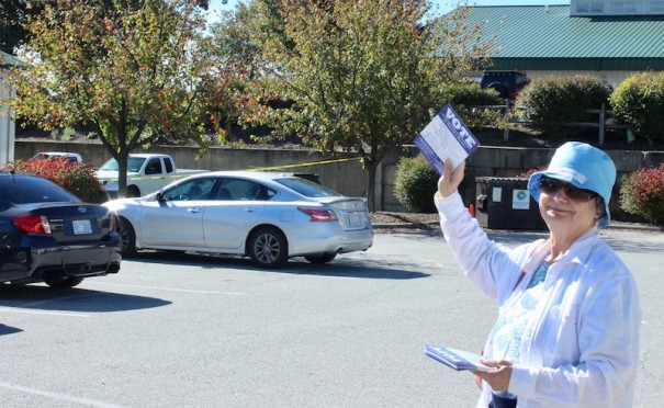 Ann B'Rells hands out Democratic Party material at the Henderson County Board of Elections.