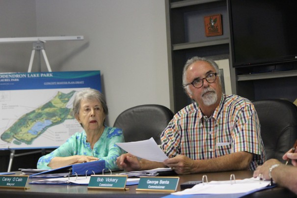 Councilwoman Dona Mennella and Mayor Carey O'Cain review a Laurel Park draft budget.