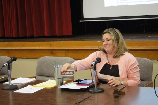 Amy Lynn Holt moves to the center of the board table as the new chair of the Henderson County School Board.