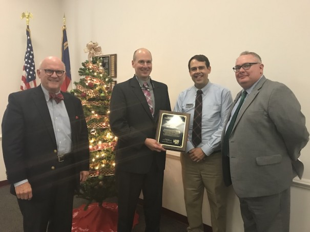 John Connet, second from left, receives award from Land of Sky Regional Council.