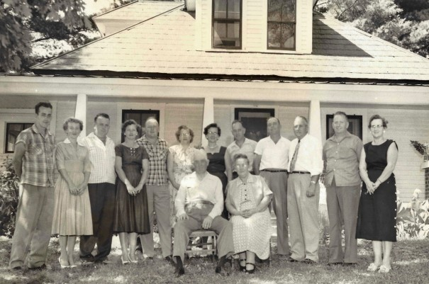 Josiah and Belle Johnson, seated, pose in 1957 with their children Jack, Nancy, Whitt, Carolyn, Jim, Katherine, Louise, Al, Pete, Mutt, Joe and Ruby. [PHOTO COURTESY OF NANCY JOHNSON HARRELSON]