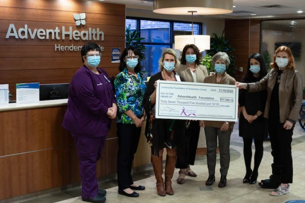 Kenmure Fights Cancer Board President Susan Bush presents a check for $37,500 to AdventHealth Hendersonville Foundation. [CONTRIBUTED PHOTO]