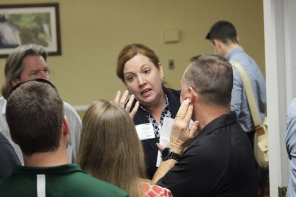 Kristina Miller speaks with residents at a public input meeting on proposed Balfour Parkway corridors on Feb. 27.