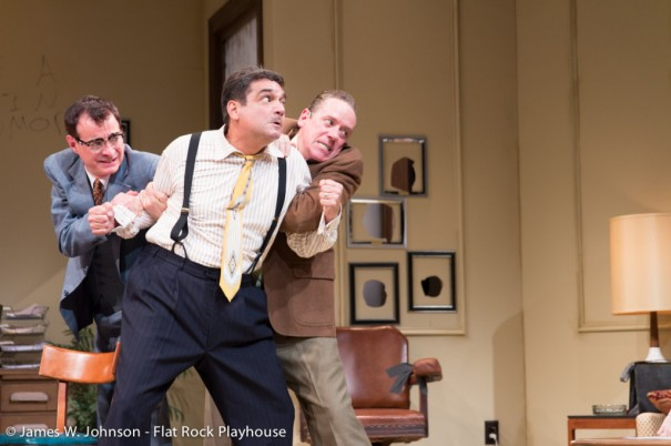 Scott Treadway (Kenny) and Michael MacCauley (Brian) restrain Nick Santa-Maria, who stars as Max in 'Laughter on the 23rd Floor' [PHOTO BY JAMES W. JOHNSON]