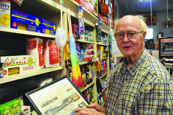 Town Commissioner Leon Morgan, owner of M.A. Pace general store, favors letting voters decide whether all restaurants and bars can serve mixed drinks.