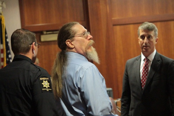 Leonard Schalow, with his attorney Dennis Maxwell, faces trial in November on 20 assault and child abuse charges.