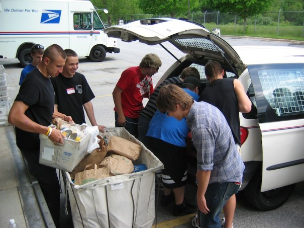 Volunteers pitch in during last year's food drive. This year's event takes place on Saturday.