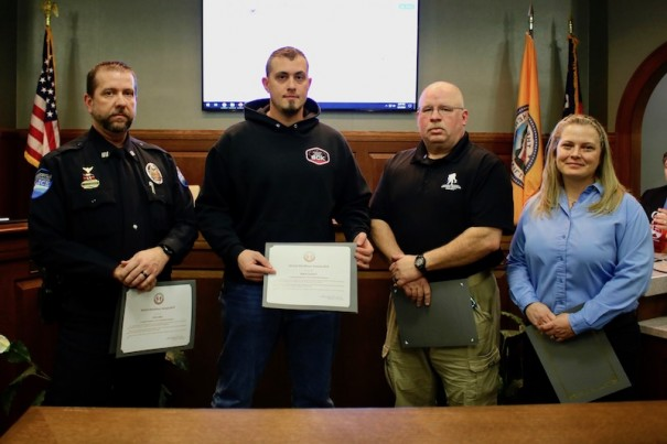 Police Capt. Chris LeRoy, Sgt. Robert Cantwell, Lt. Rich Olsen and Telecommunications Supervisor Monica Howard were honored as MVPs of the year. [PHOTO BY ALLISON NOCK, CITY OF HENDERSONVILLE]